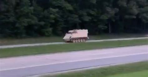 Dozens of police cars chase 'stolen' armoured personnel